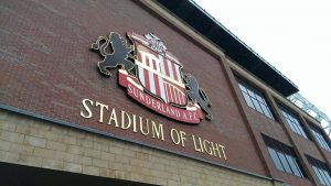 The crest of Sunderland football club glimmers on the side of The Stadium of Light, home to Sunderland football club