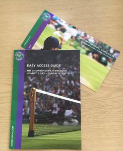 A copy of Wimbledon's easy access guide to assist wheelchair users, and the cover of a ticket for Wimbledon with a ball boy looking onwards.
