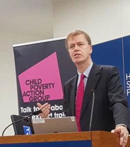 Stephen Timms MP picture of the Member of Parliament, he is white, light build and short hair. Wearing a blue shirt and tie.