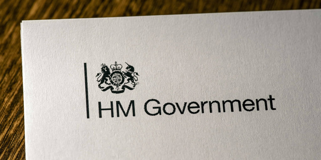 HM Government logo on the front cover of the document Our Plan To Rebuild - the UK Governments COVID-19 recovery strategy.